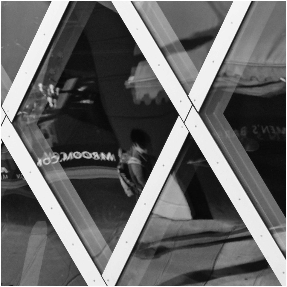 Black and white photo of diamond windows and reflections