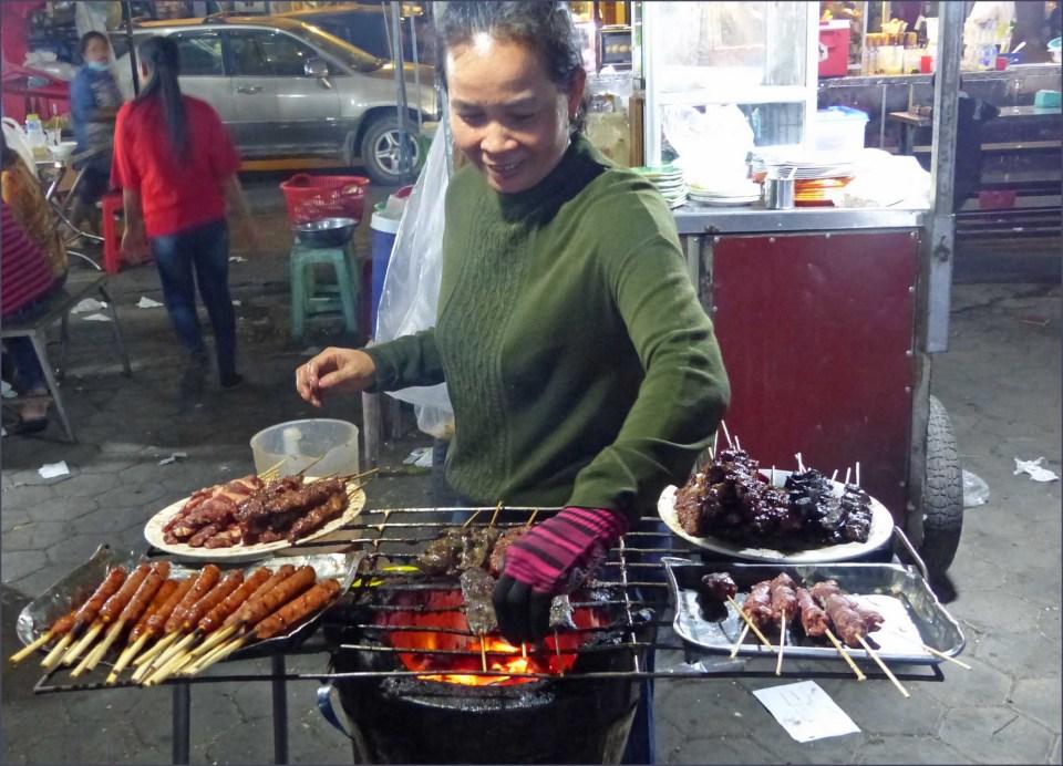 Woman frying on an open fire