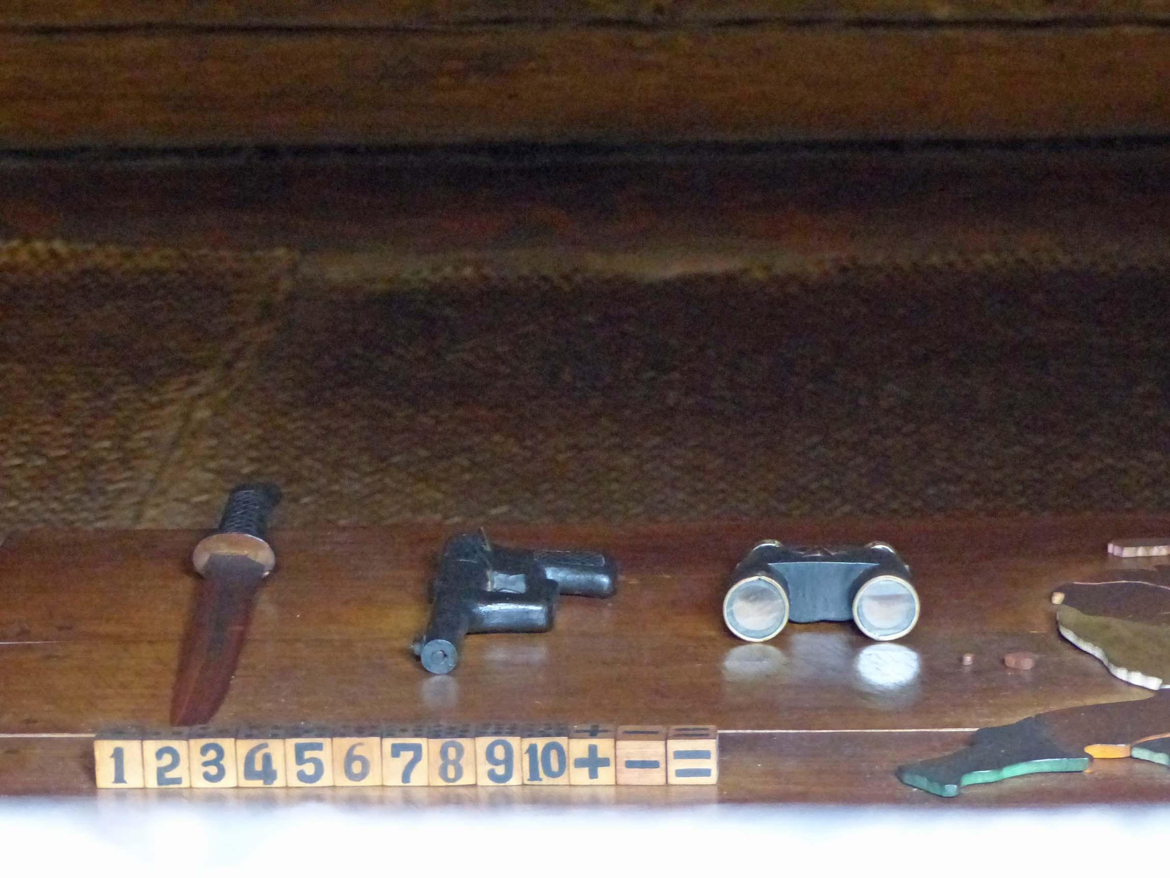 Counting blocks, knife, toy gun