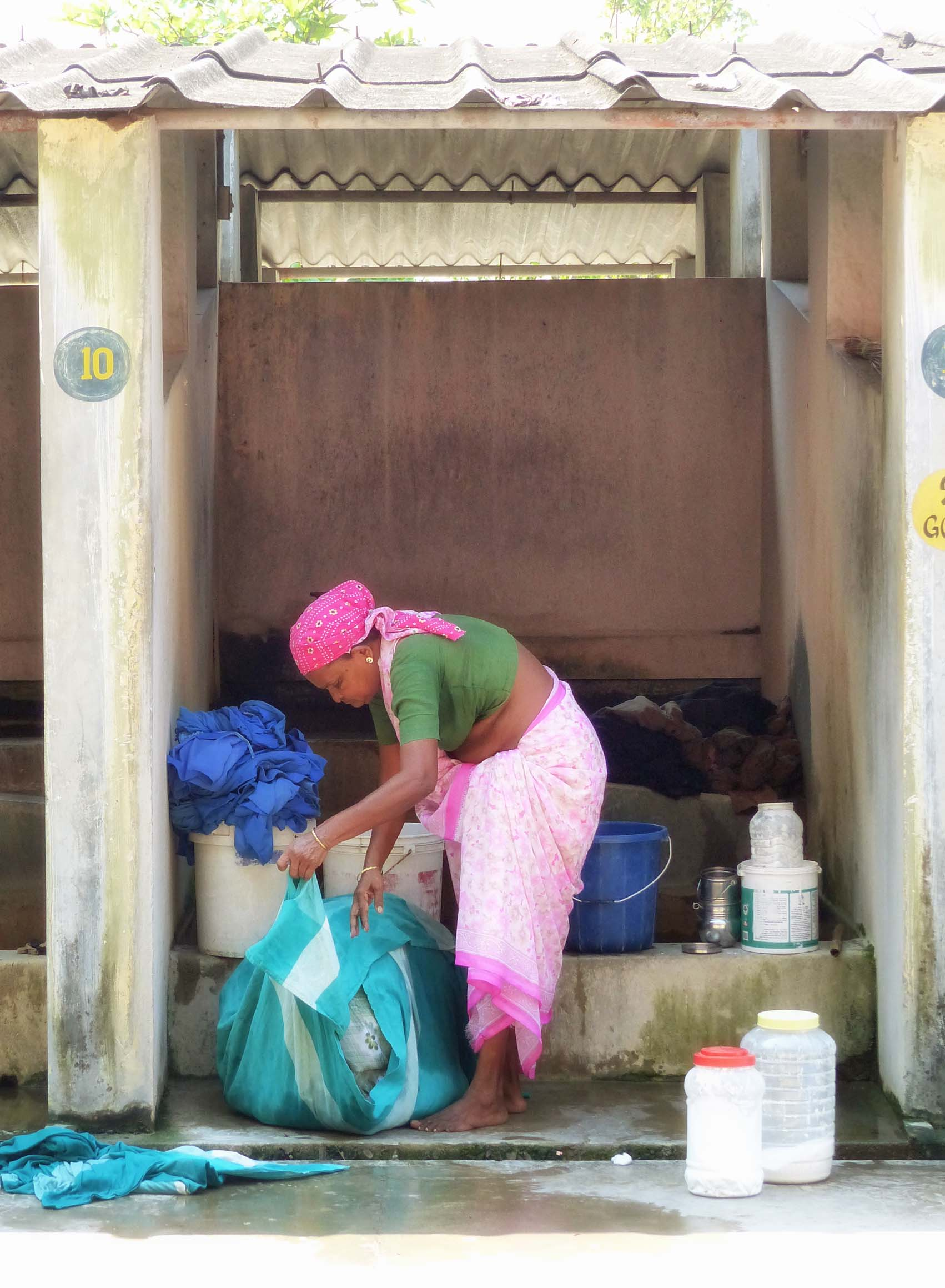 Woman washing clothes in a stone building