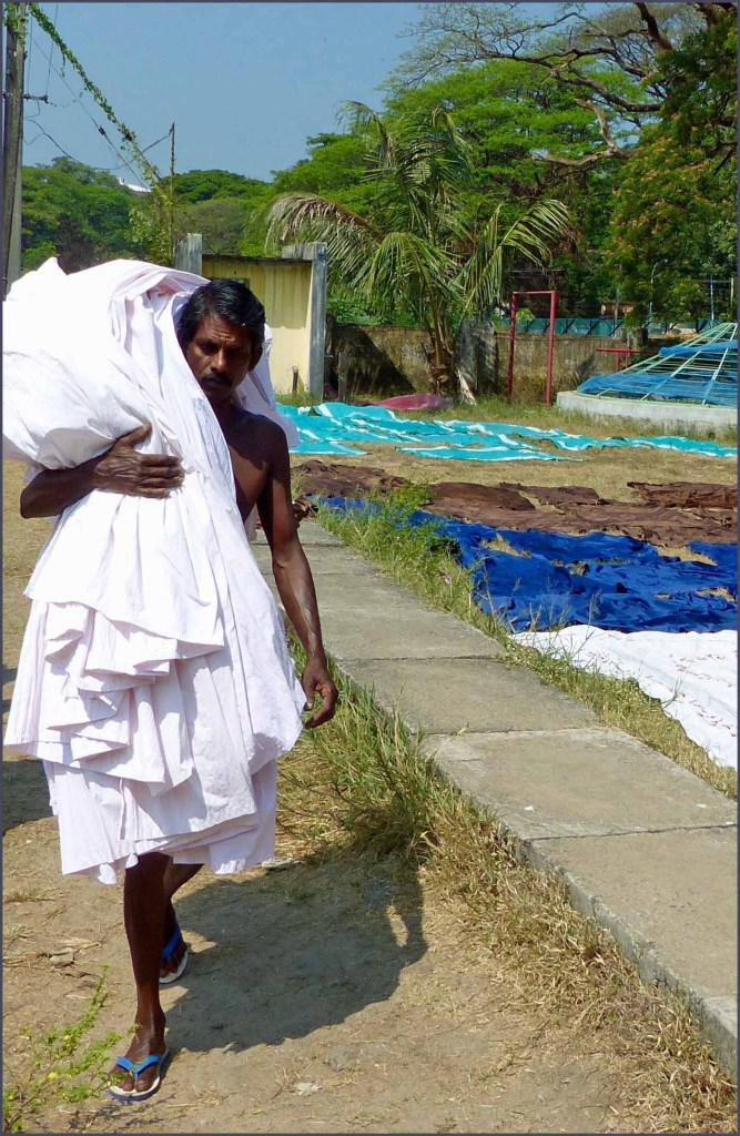 Man carrying white cloth