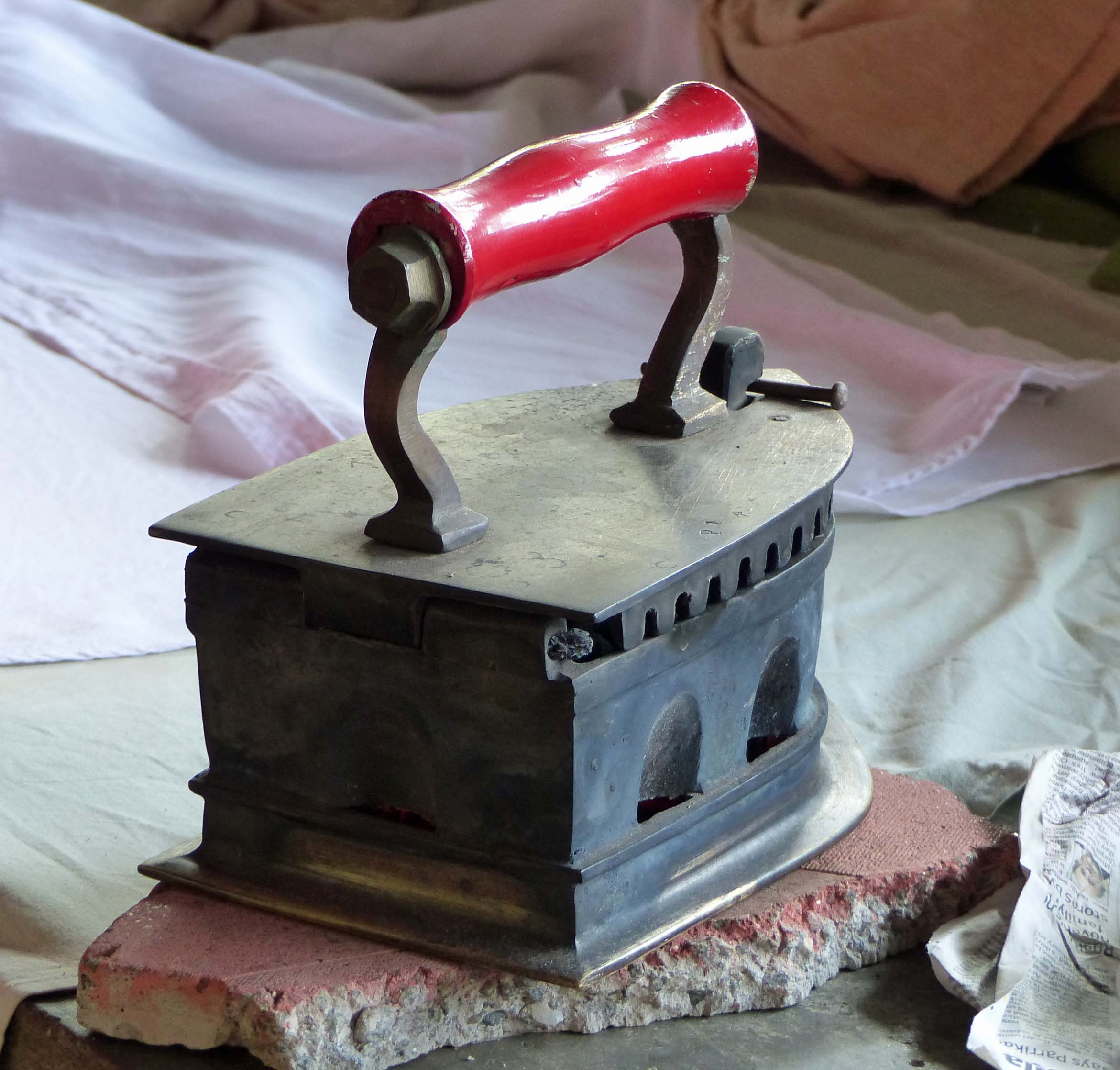 Traditional iron with red handle