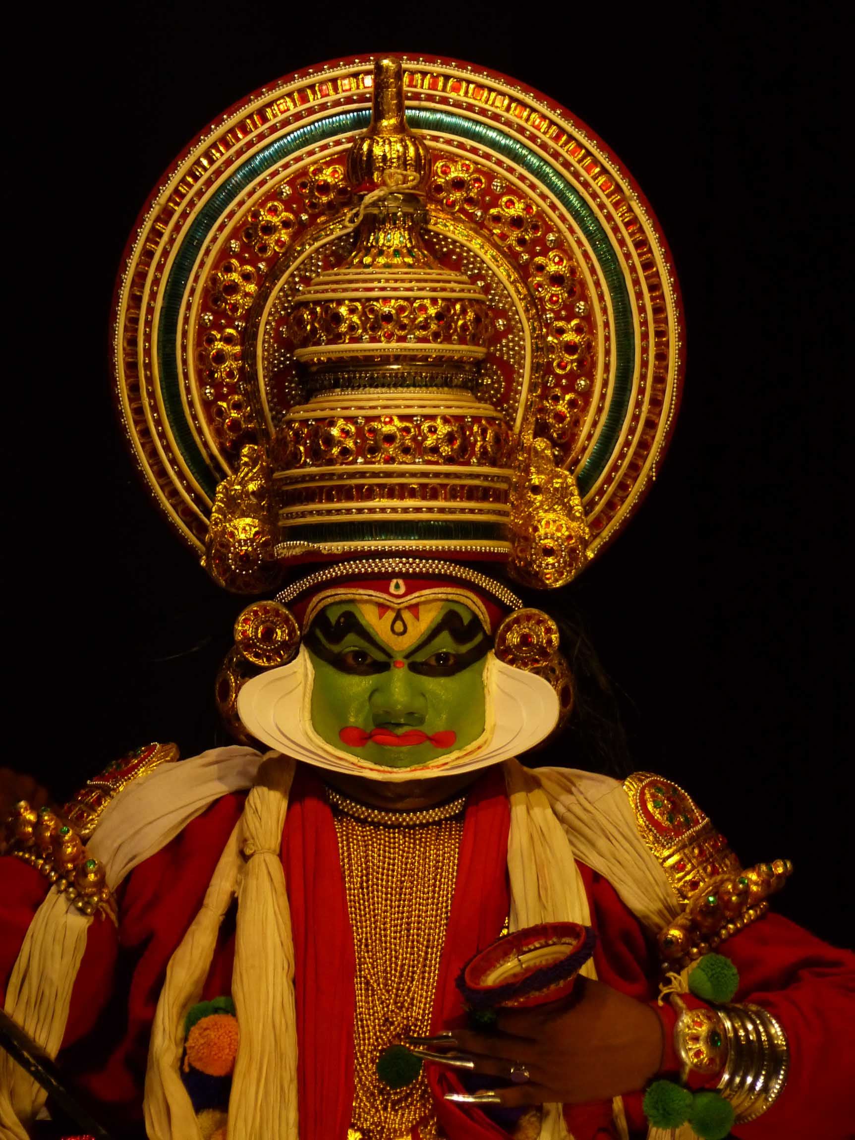 Man in costume and colourful face paint