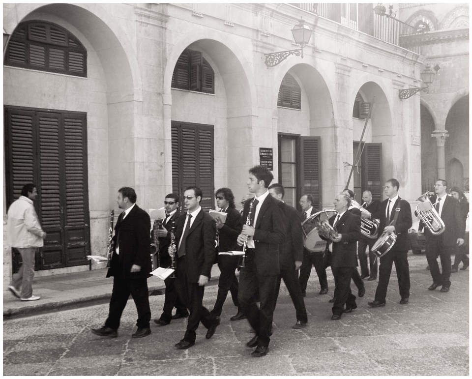 Monochrome photo of men with musical instruments