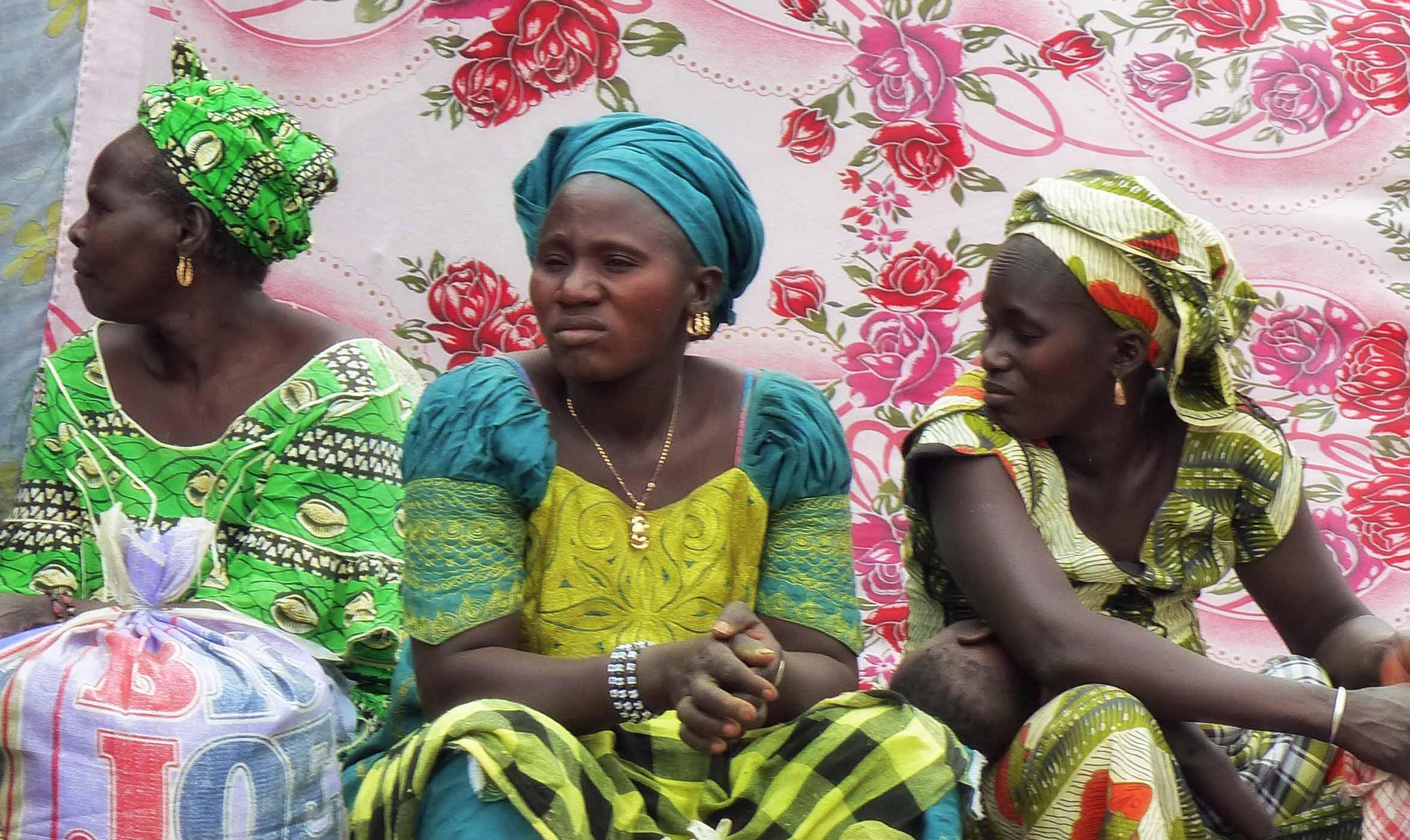 Three ladies in African dress