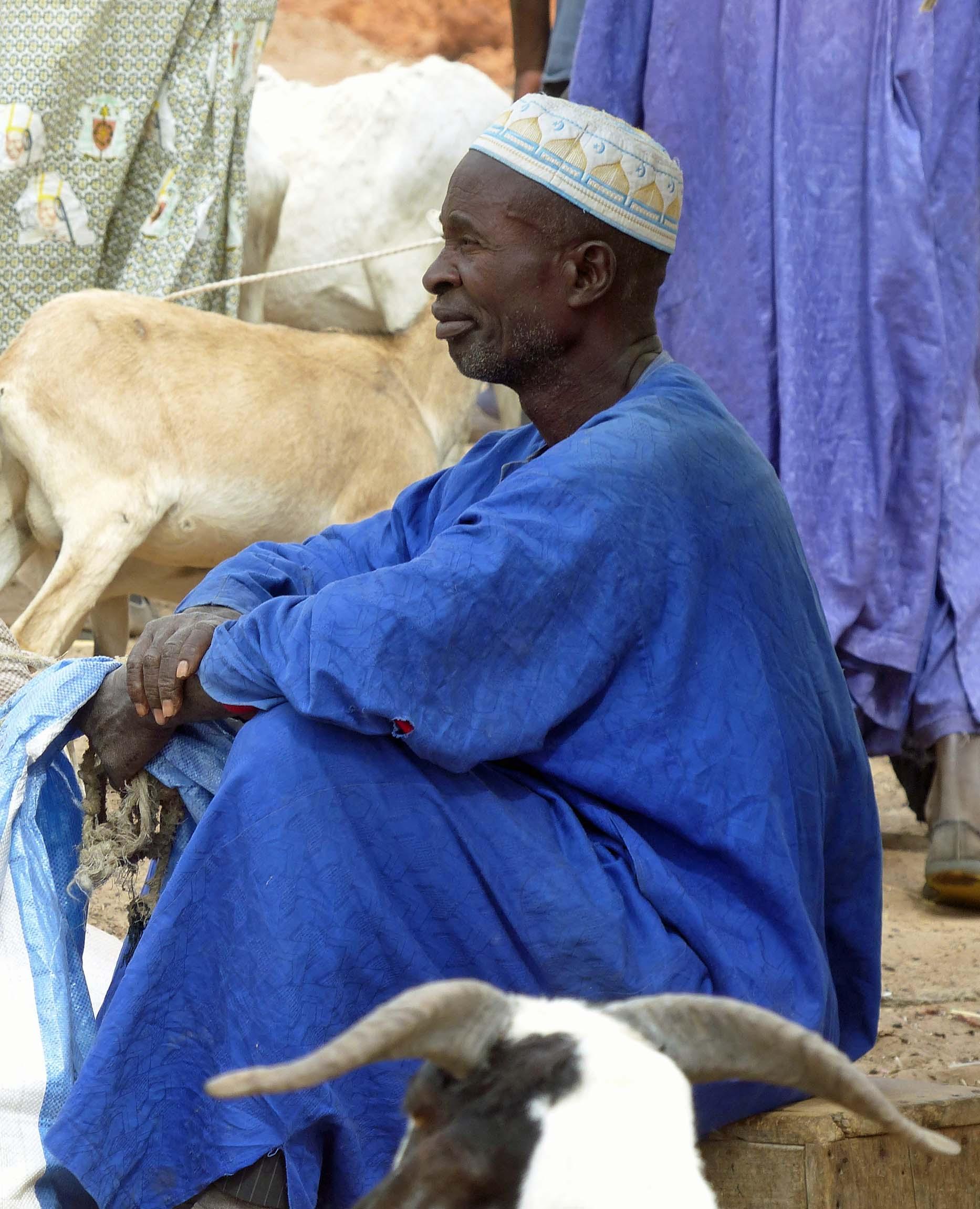Man in blue African dress