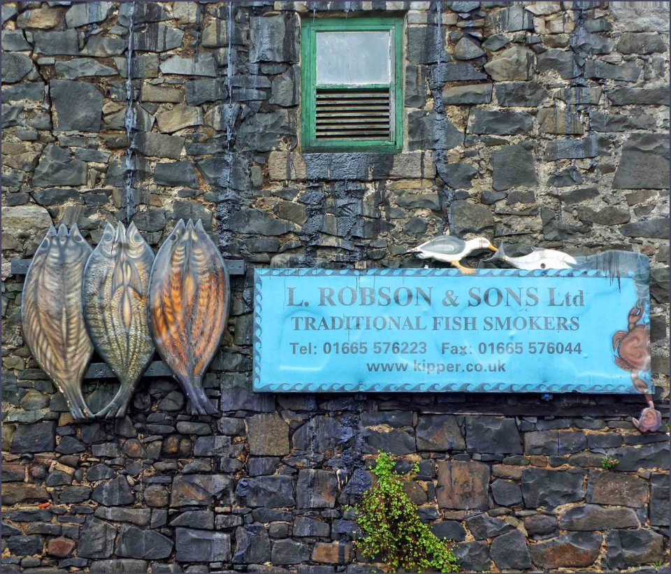 Sign and tin kippers hanging on a wall