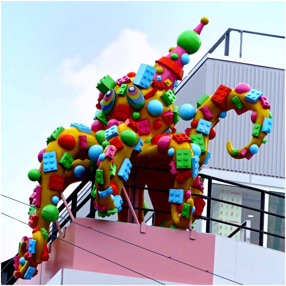 Colourful large octopus sculpture on a rooftop