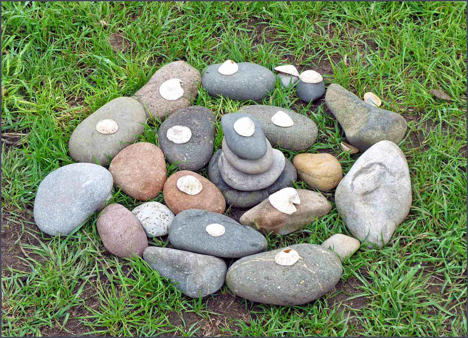 Stones arranged in a circle on grass