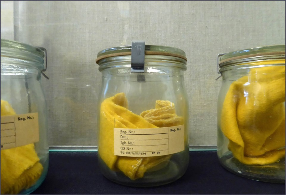 Glass jars with yellow cloths inside