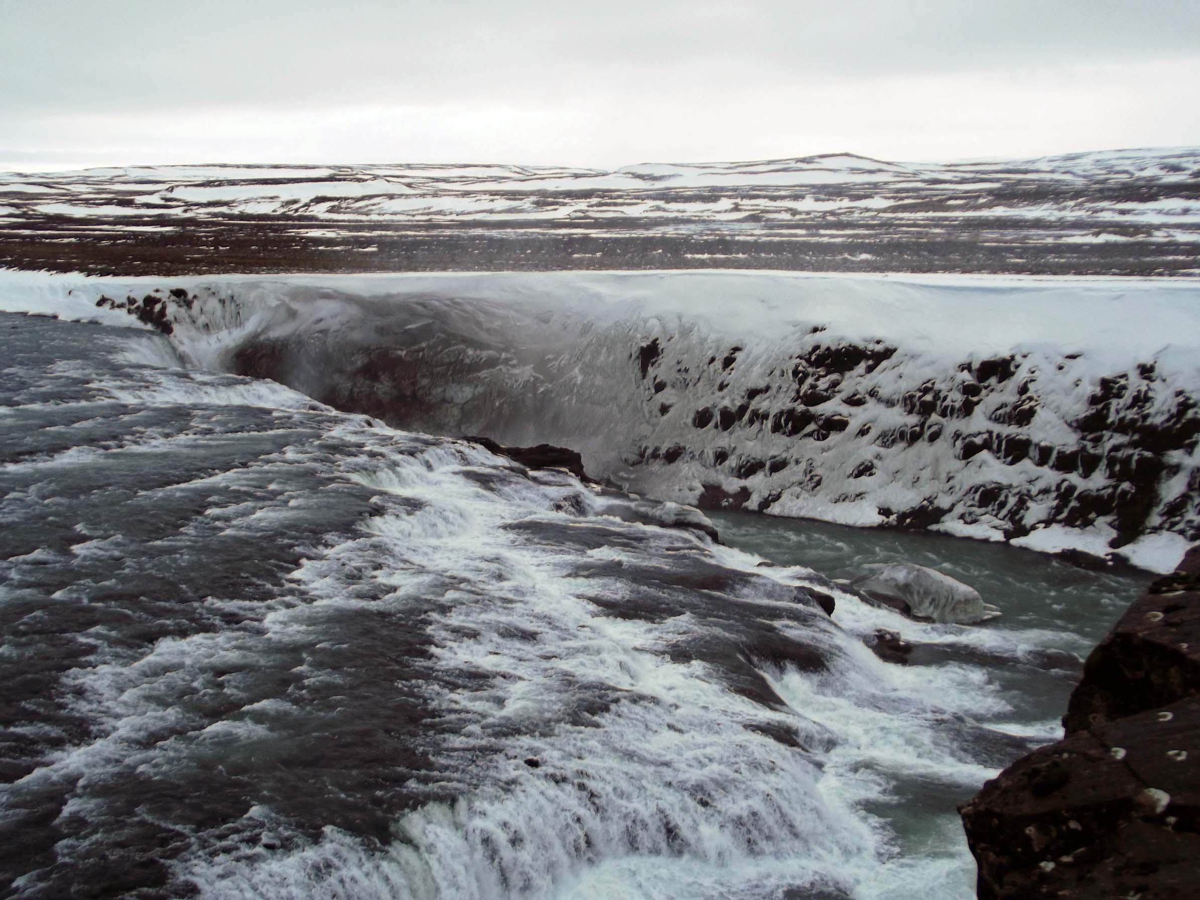 Large waterfall in snowy landscape