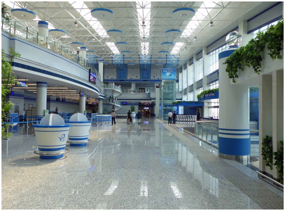 Shiny airport with handful of people