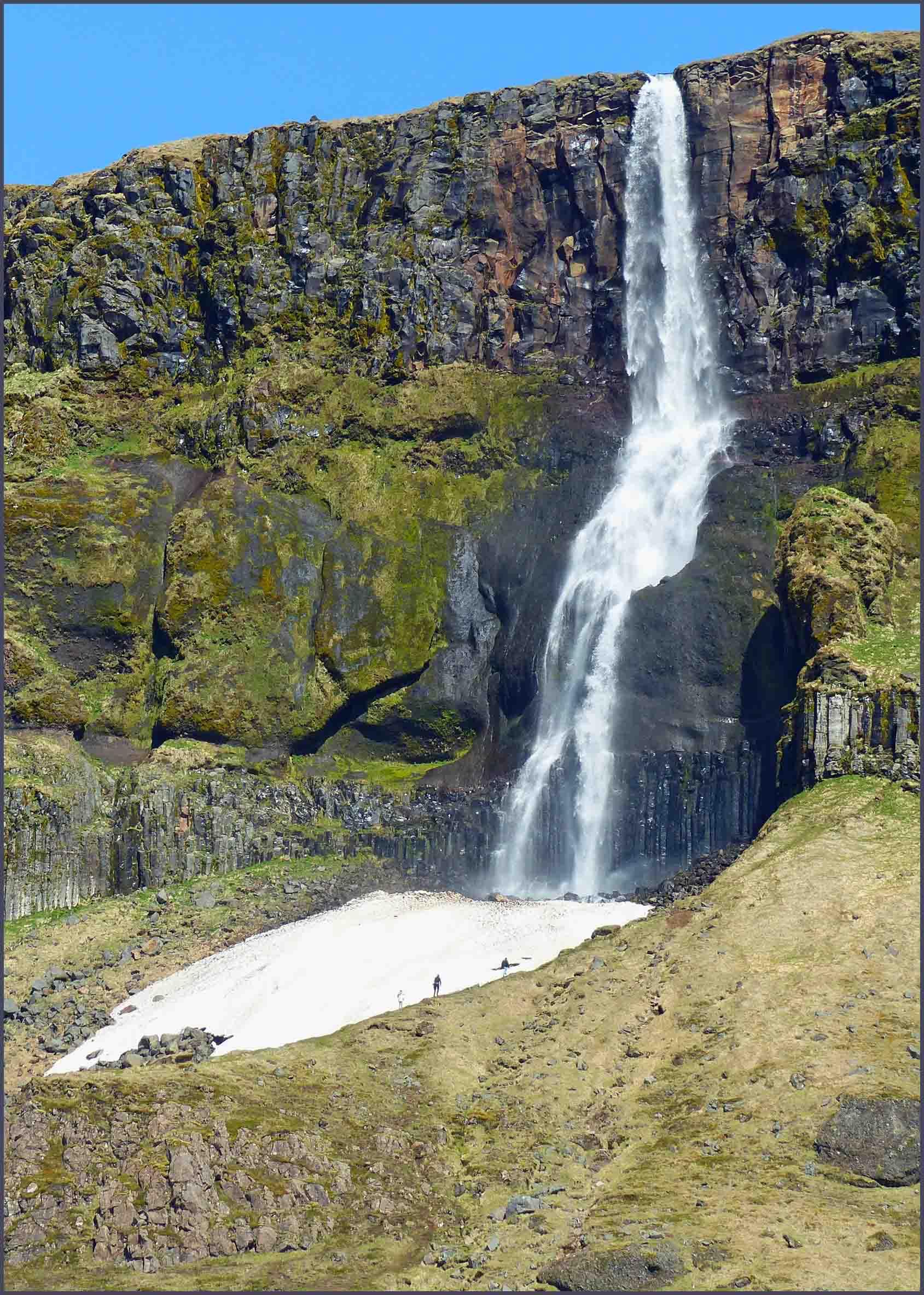 Veil-like waterfall and small glacier
