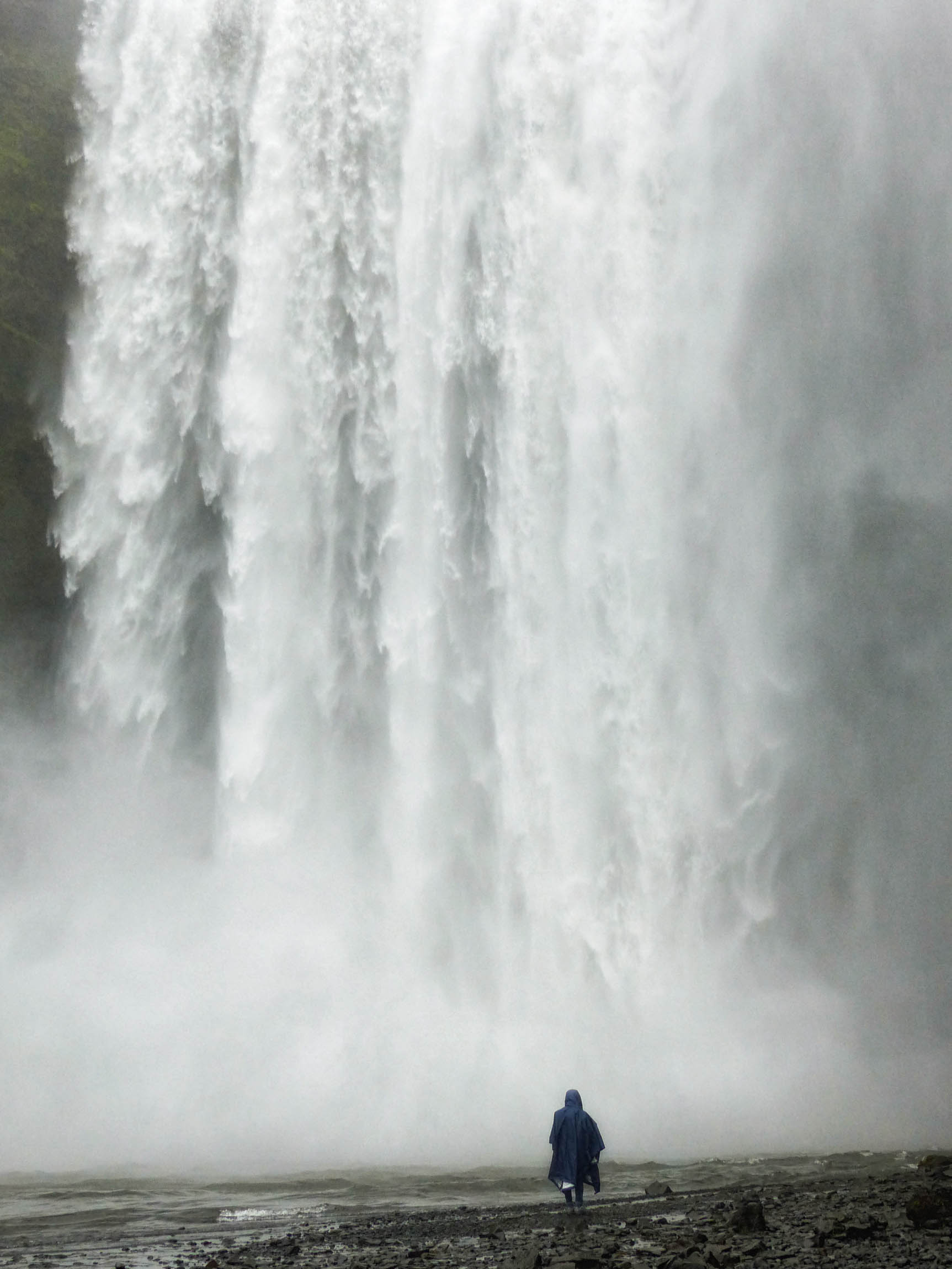 Large waterfall with person in front