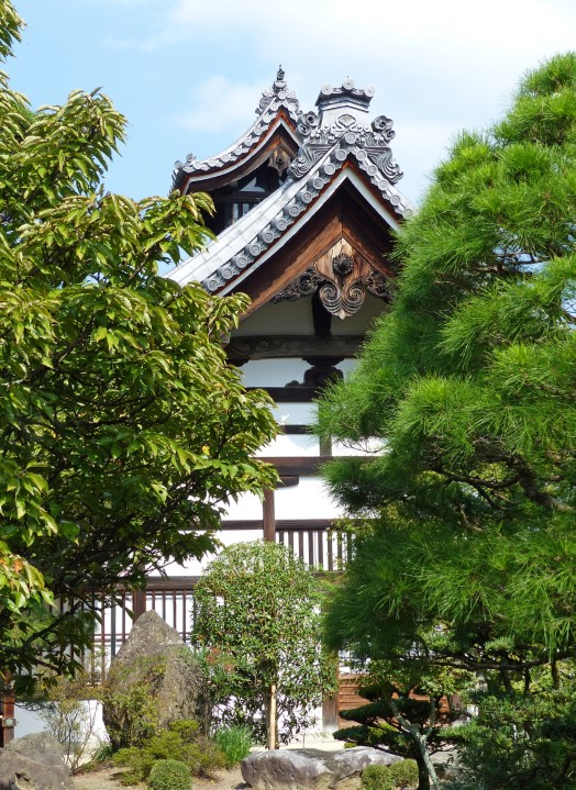 Japanese temple surrounded by trees