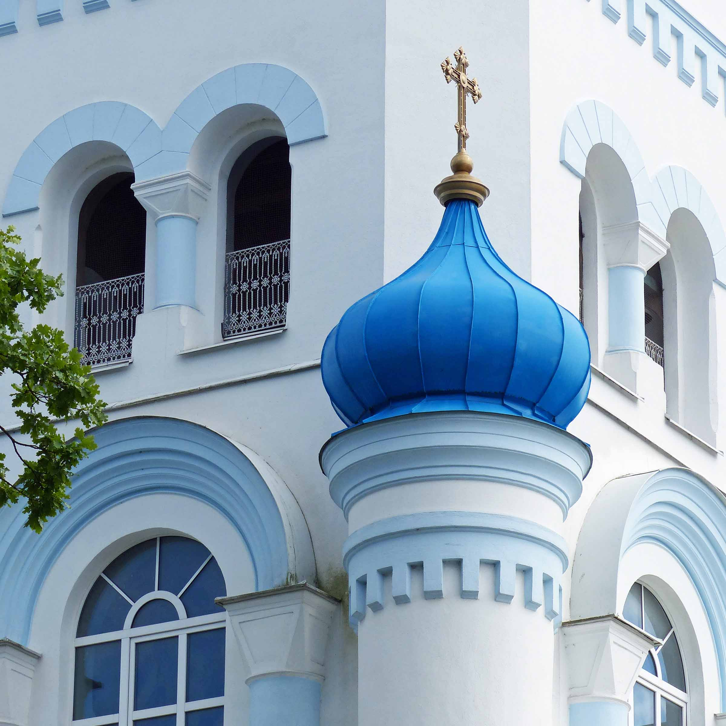 White Orthodox church with blue dome