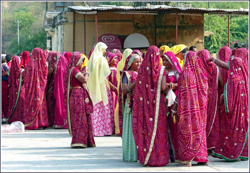 Group of ladies in pink saris
