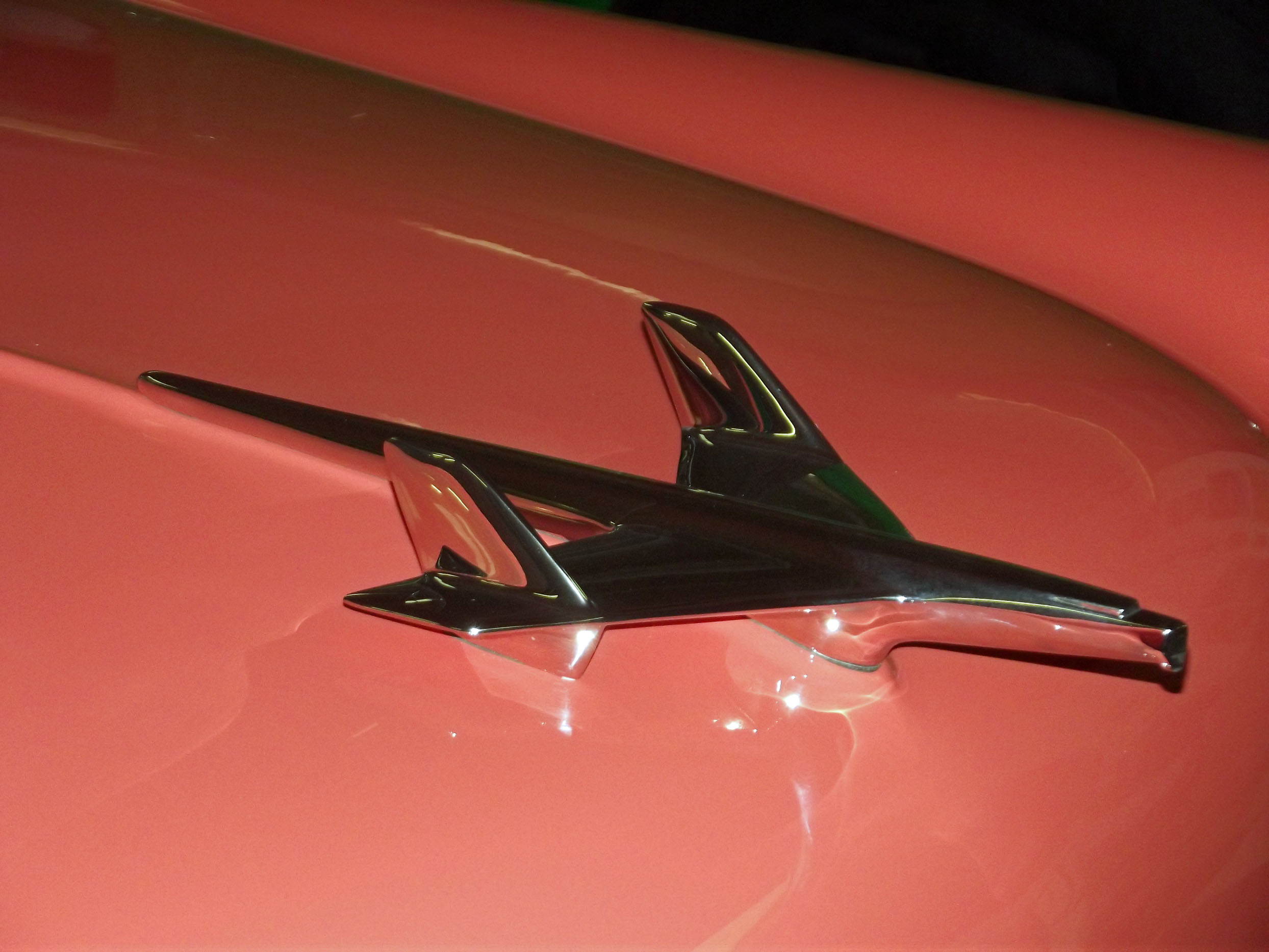 Detail of salmon pink car with silver trim