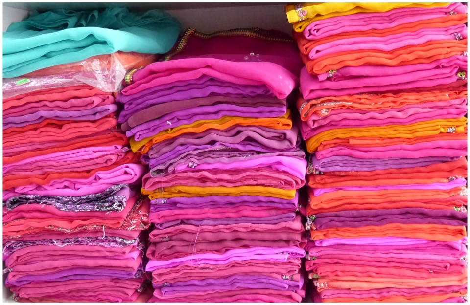 Piles of folded pink fabric