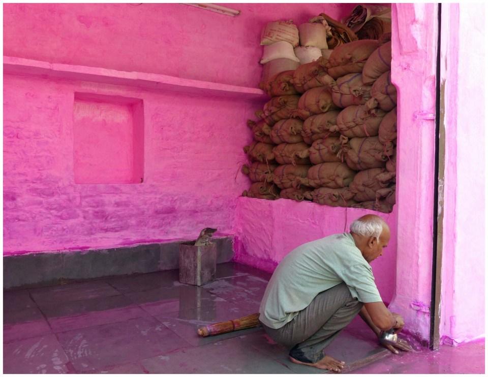 Man painting walls a vivid pink