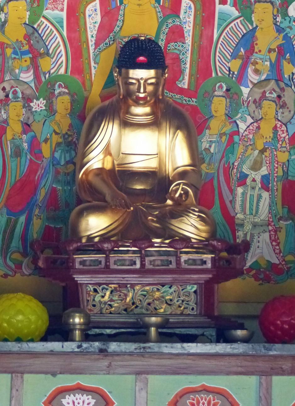 Gold Buddha statue on an altar