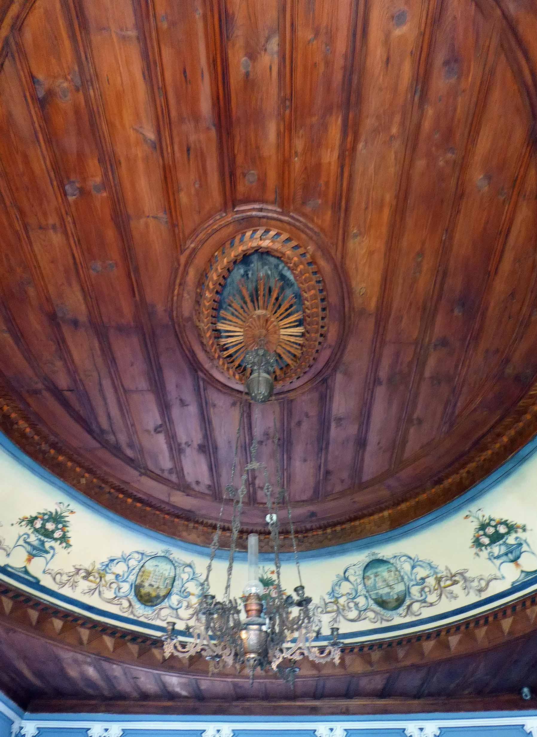 Carved wooden ceiling with painted frieze