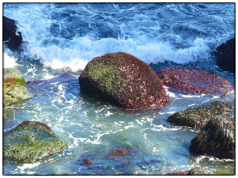 Colourful rocks and breaking waves