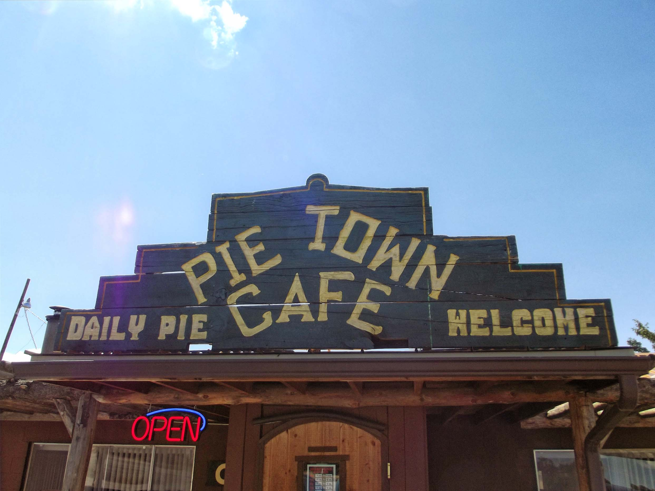 Wooden cafe building with large sign