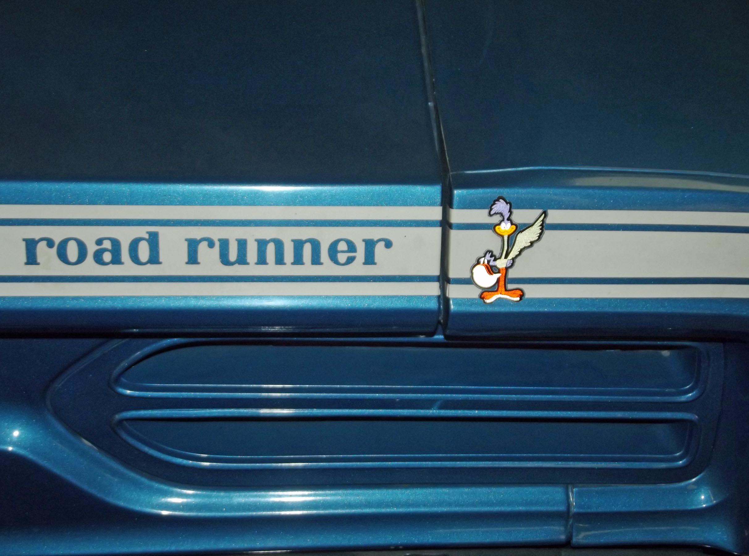 Blue car with roadrunner cartoon image