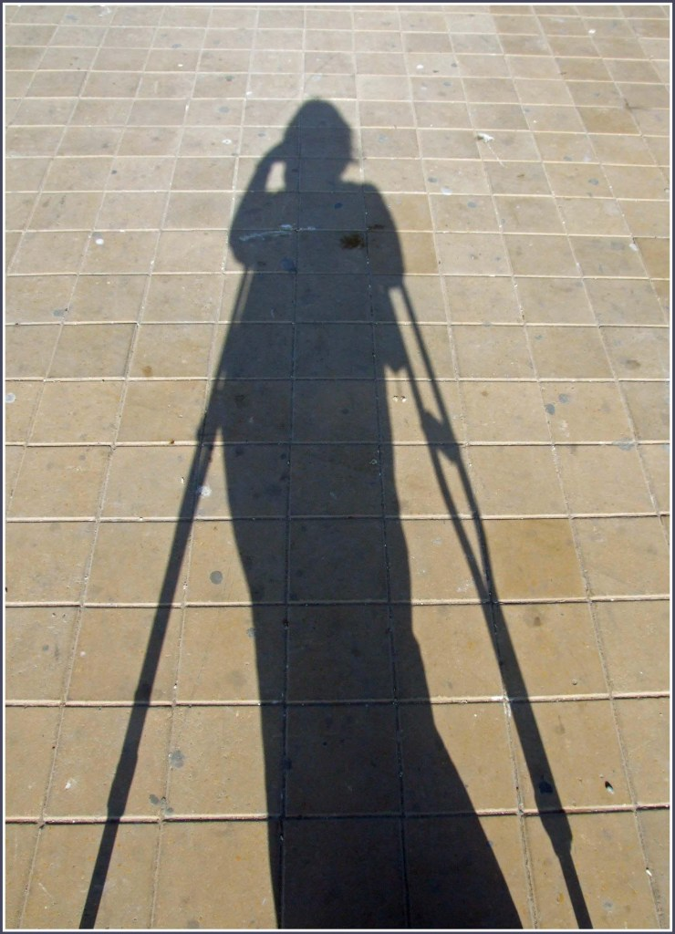 Shadow of lady on crutches