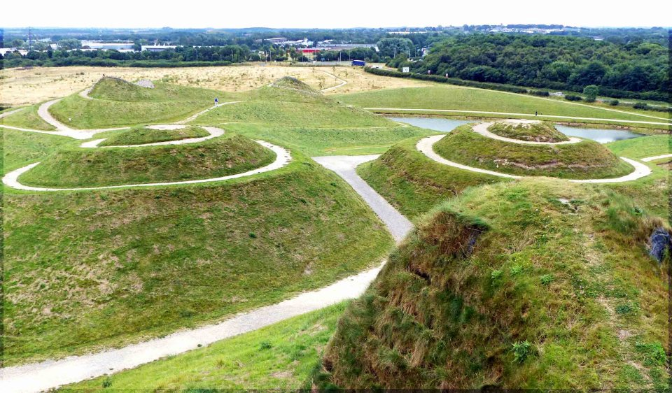 Green hillocks and winding paths