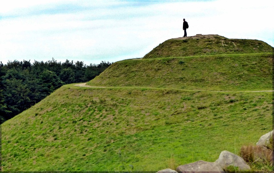 Man on a green hillock