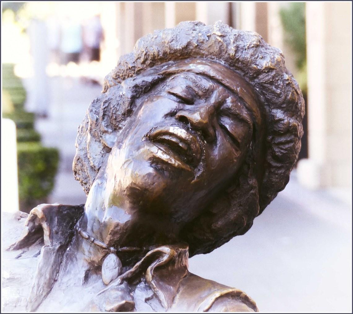 Close-up of head sculpted in bronze
