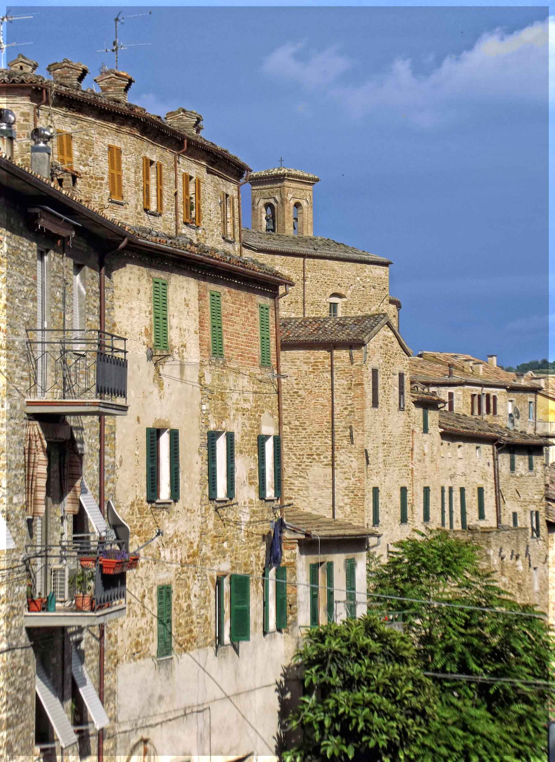 Tall stone houses forming a wall
