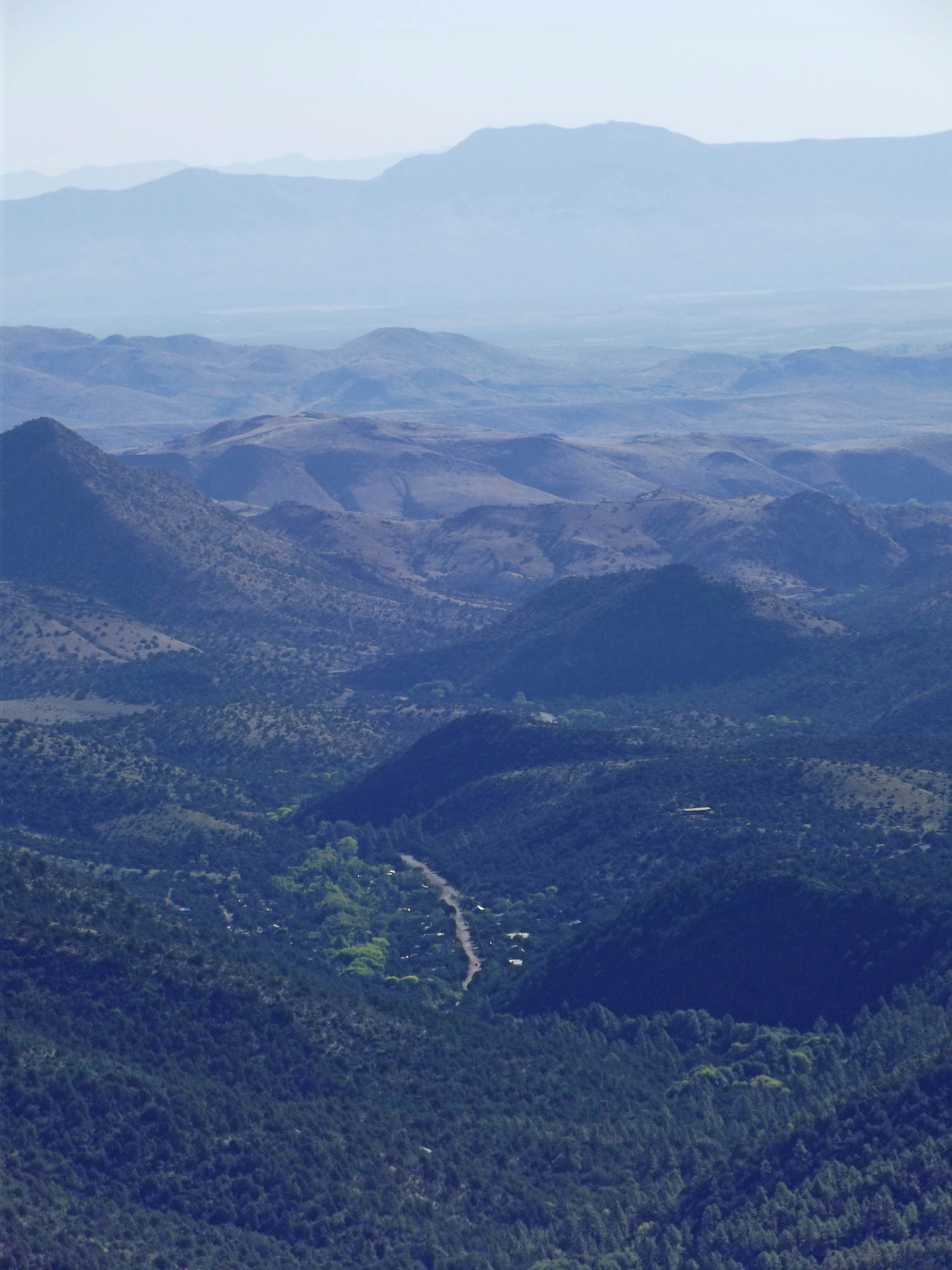 View of wooded hills and distant mountains