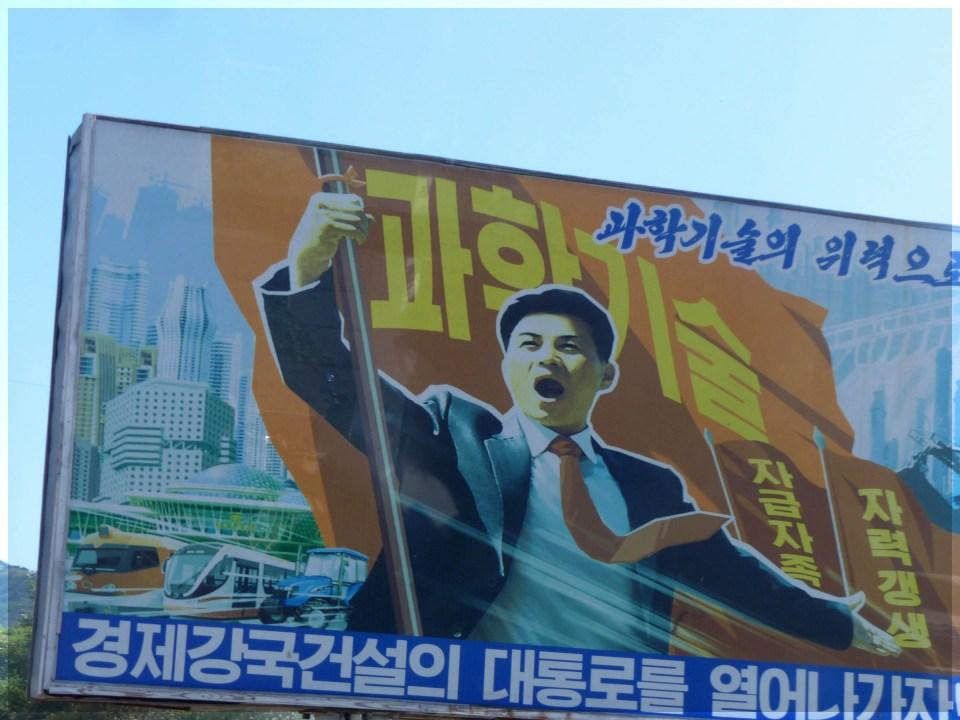 Large poster depicting man waving huge flag