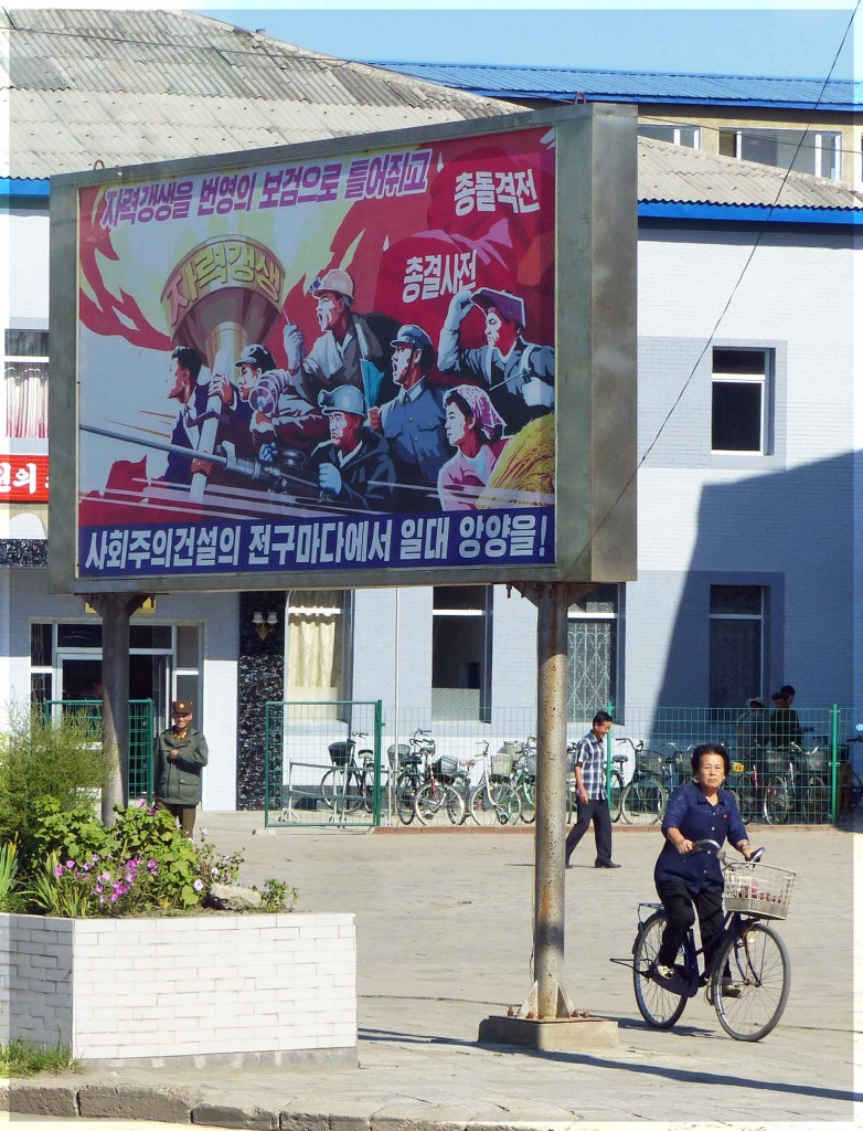 Large poster depicting group of people with flaming torch