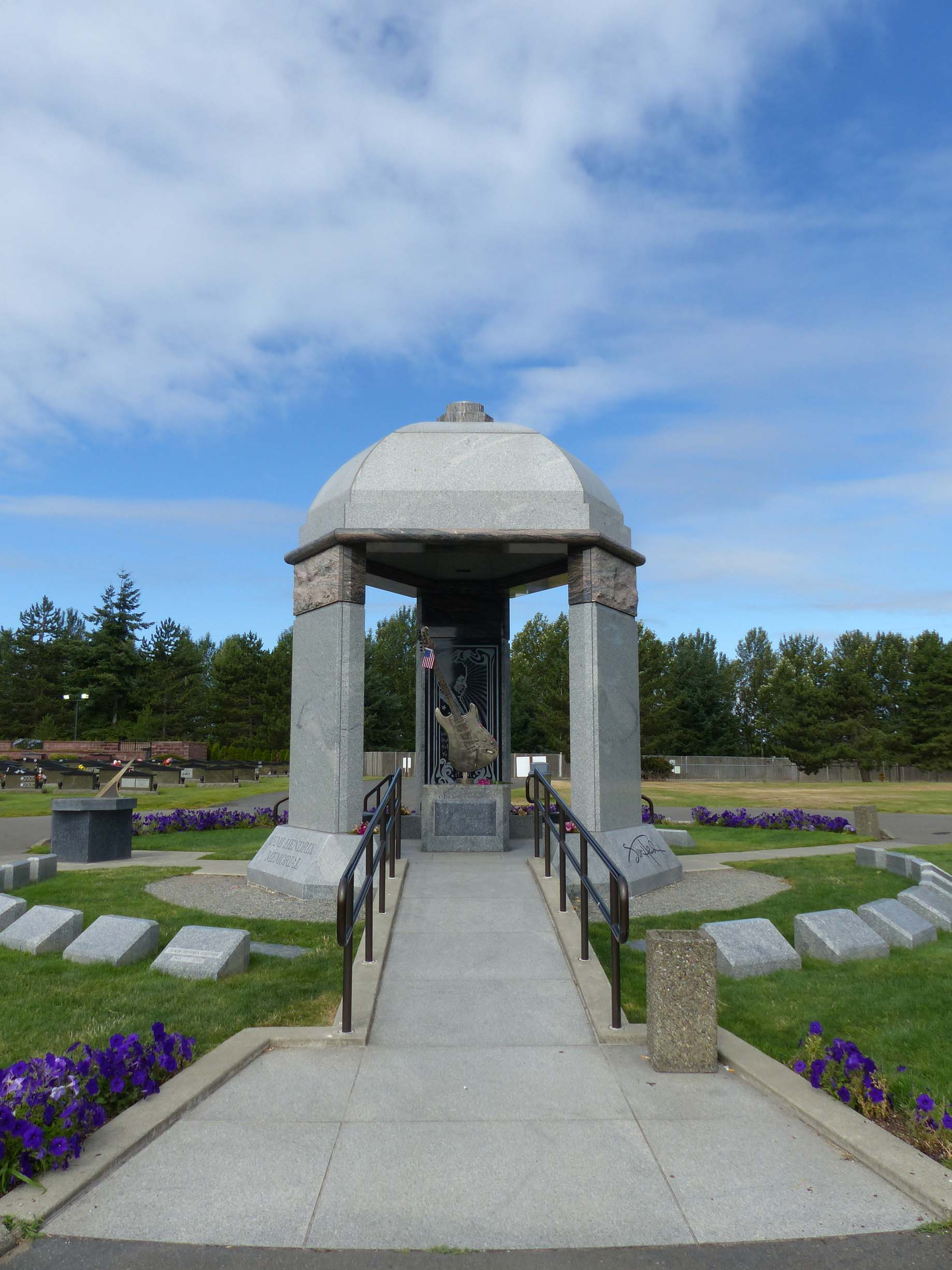 Stone memorial with flower beds