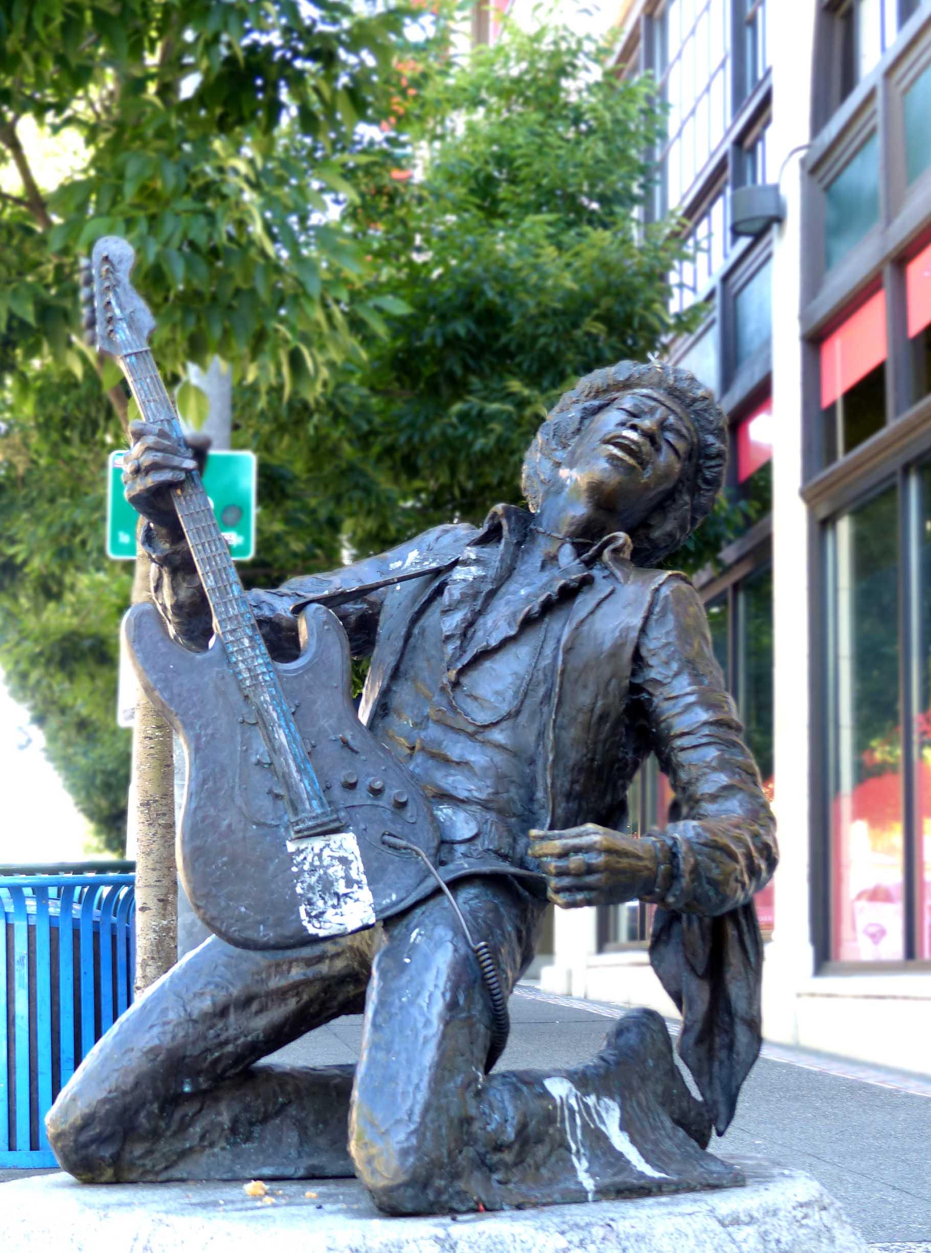 Metal sculpture of man playing electric guitar