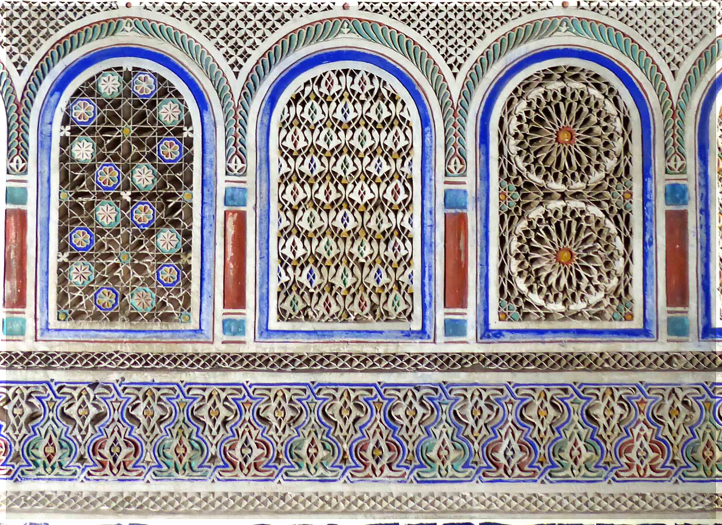 Decorative tiles in blue, green and white with arched openings