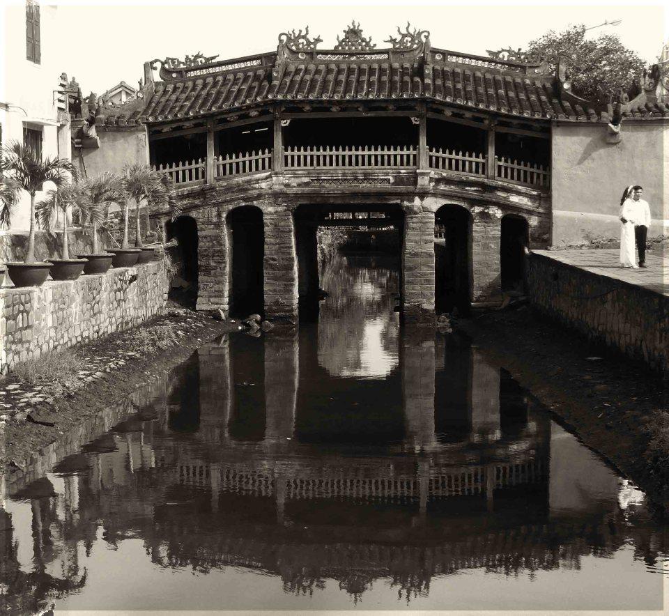 Sepia photo of old Oriental style bridge