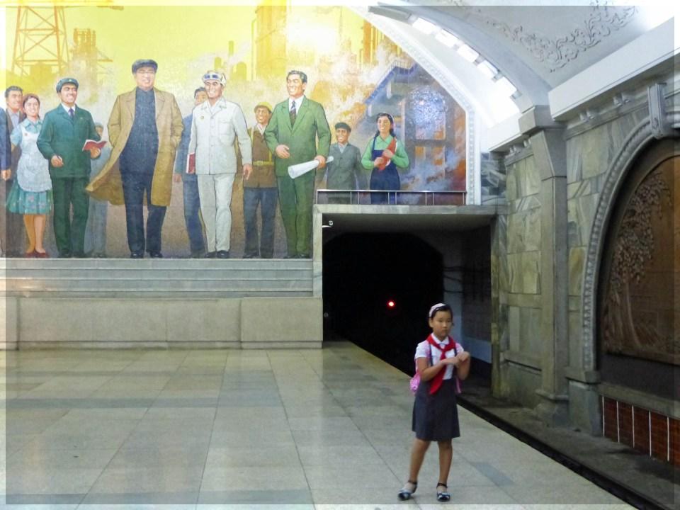 Girl in uniform on a station platform
