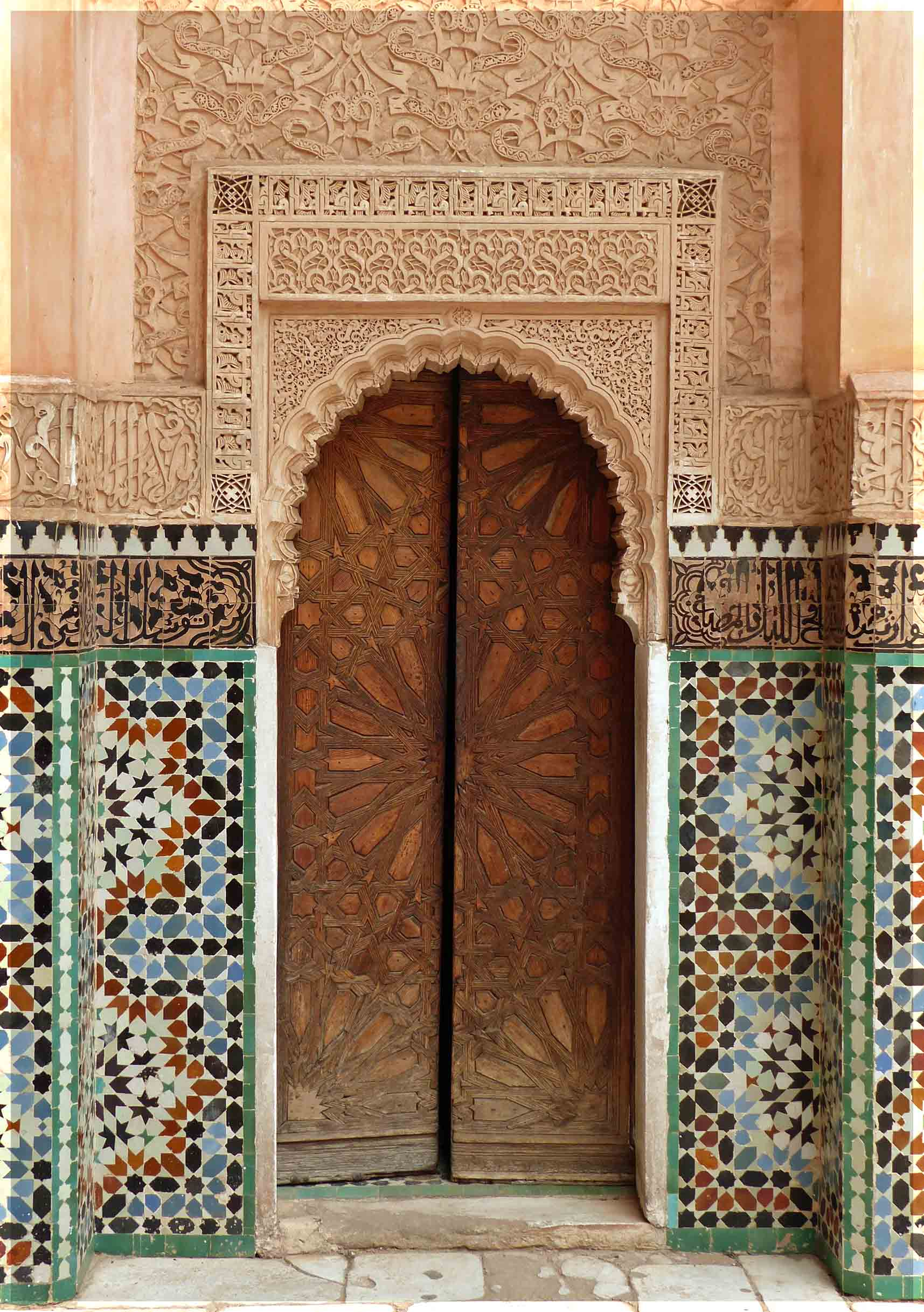 Wall with wooden door, decorative coloured tiles and stucco work