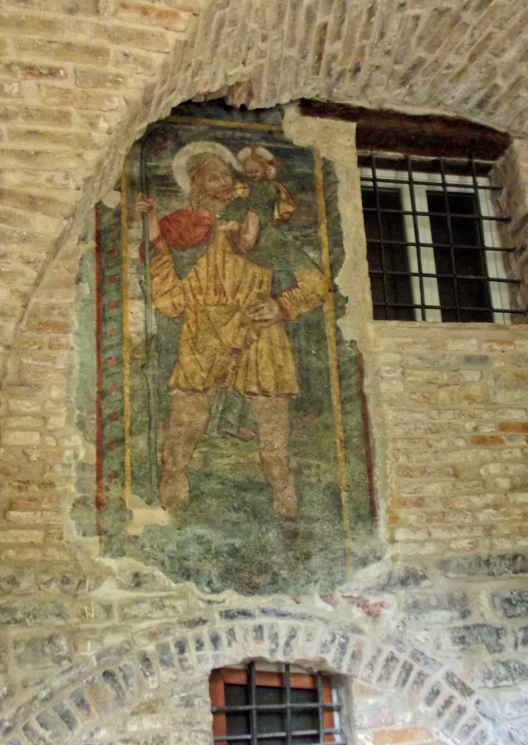 Painting of a saint on stone wall