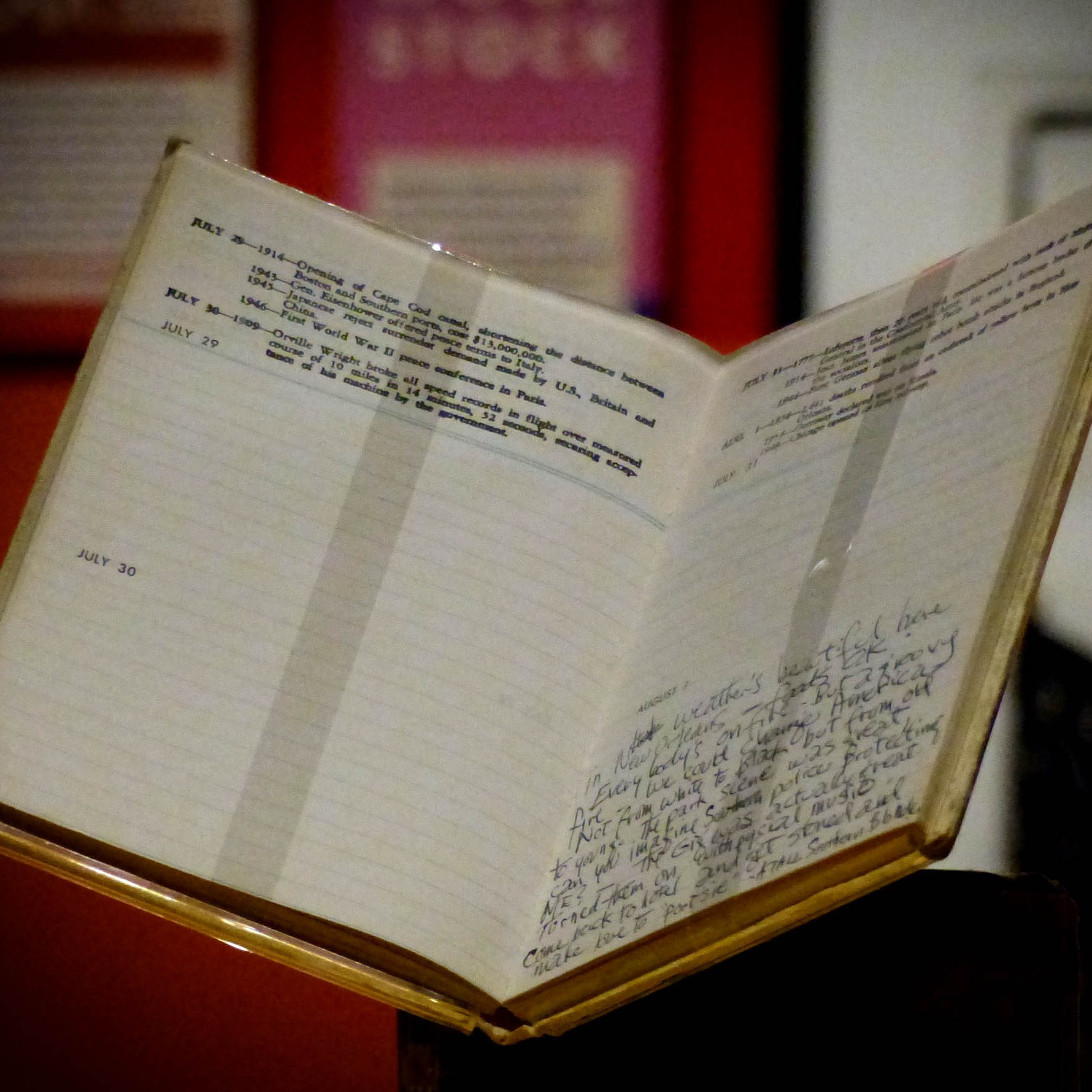 Open diary in a glass cabinet