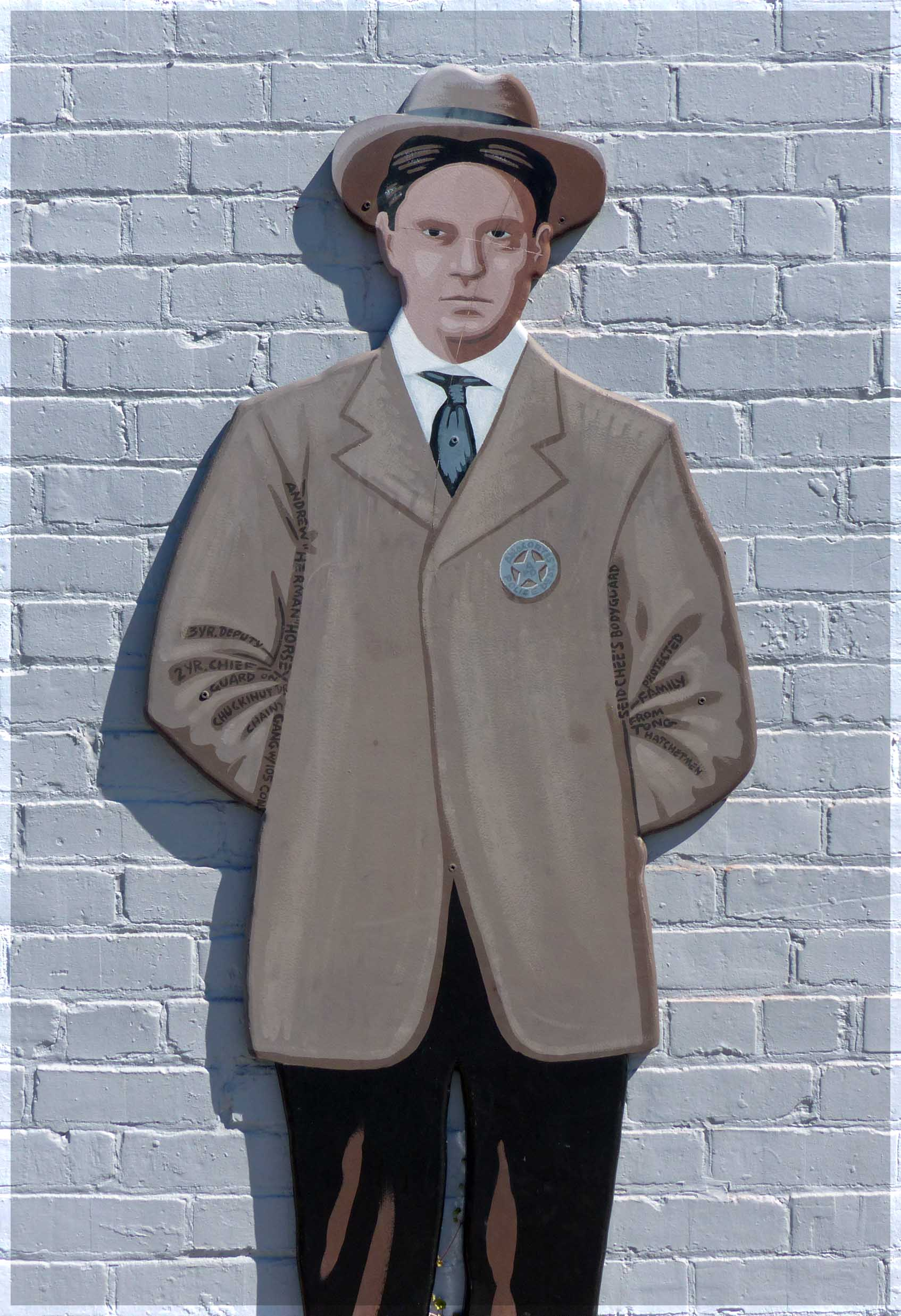 Mural of man with hat and sheriff's badge
