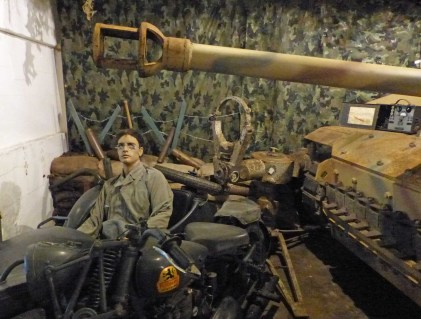 Large tank and mannequin soldier