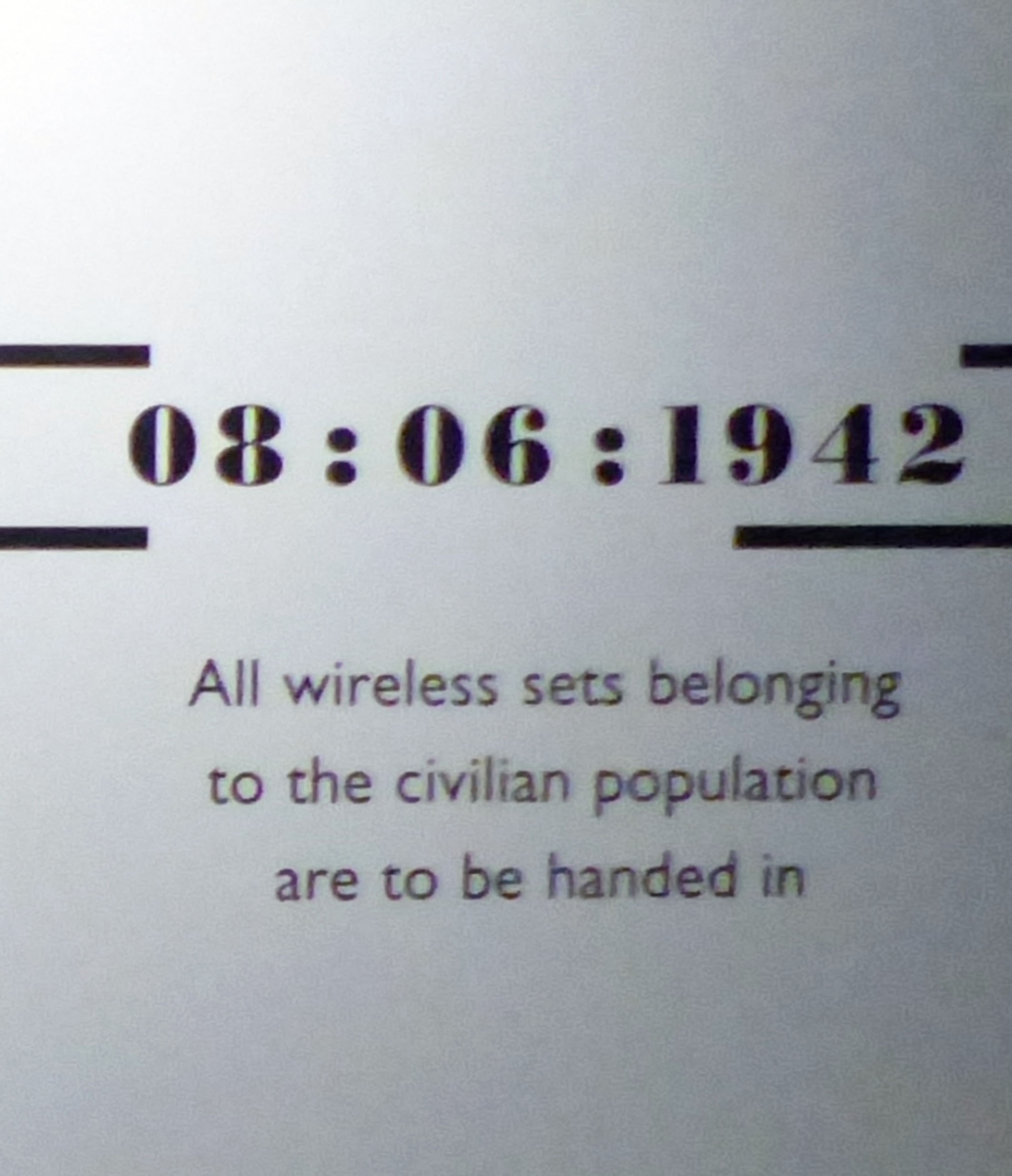 Poster with rule about handing in wireless sets