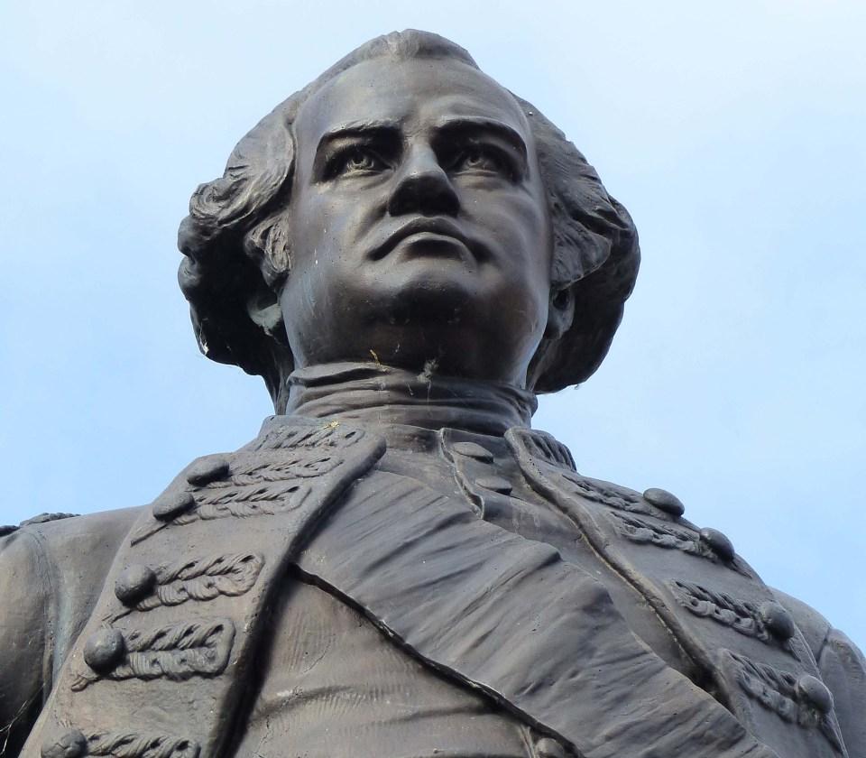 Man's head and shoulders in bronze