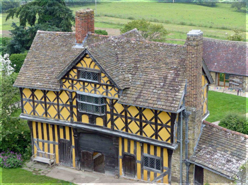 Looking down at yellow half-timbered house